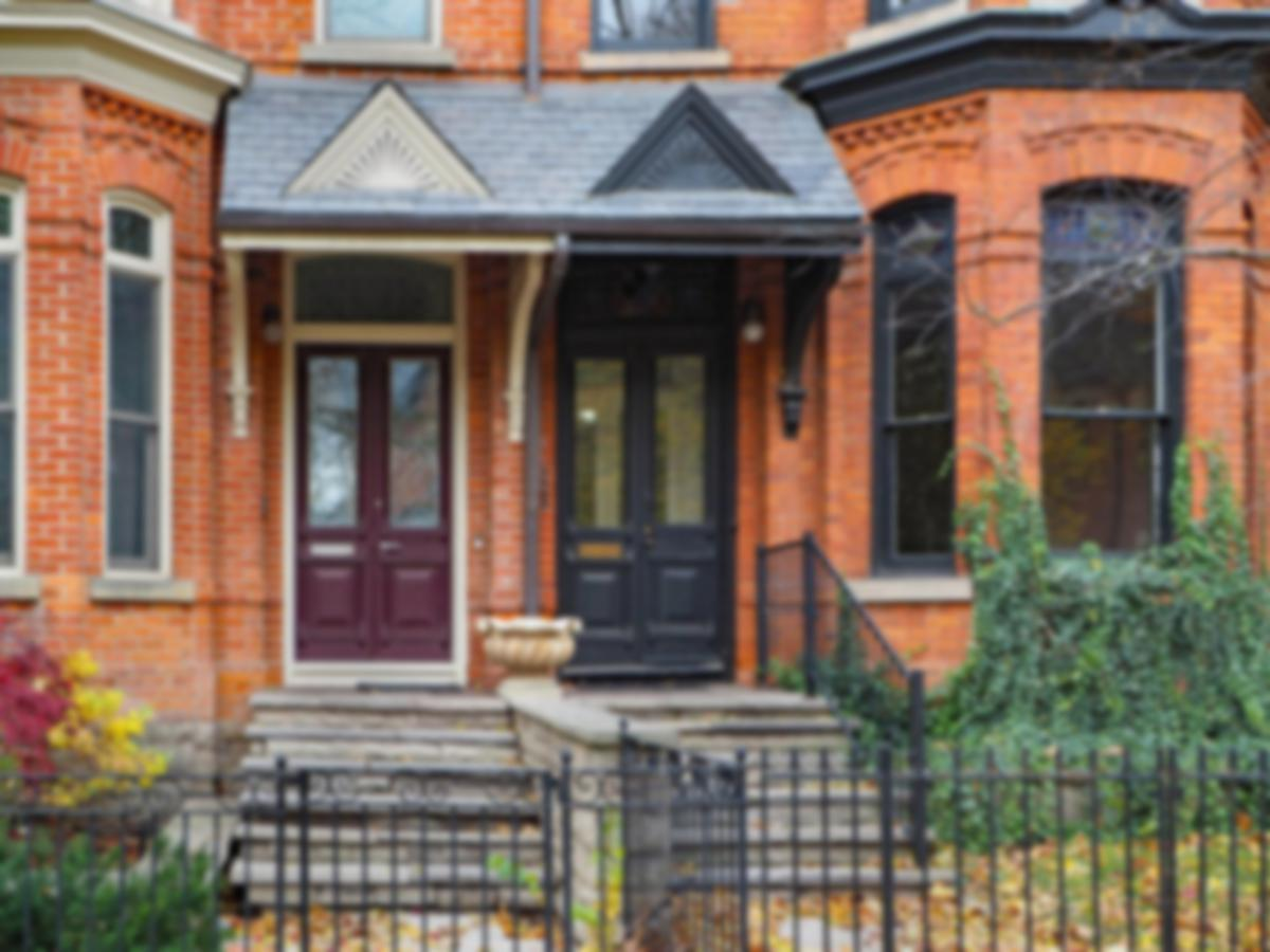 brick duplex behind iron gates