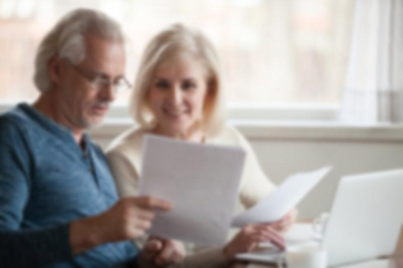 older couple reviewing investment documents