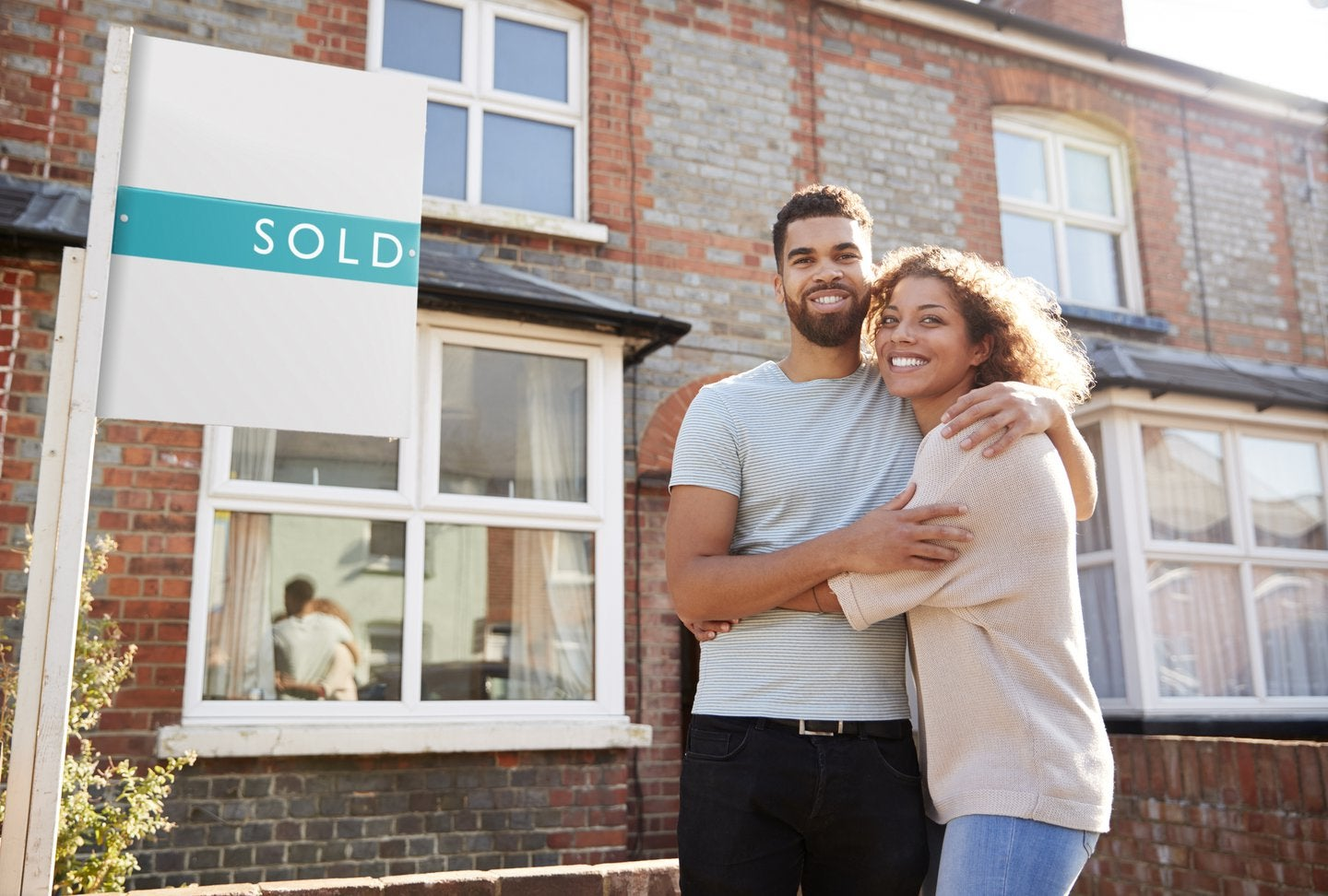 couple in a sold house