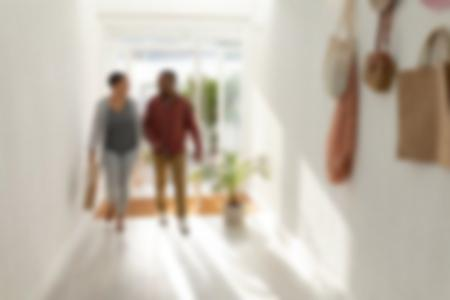 Couple entering hand in hand their home
