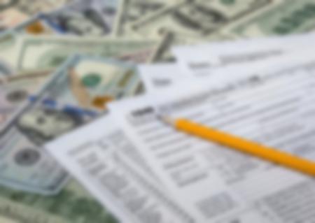 1040 tax form and dollar bills