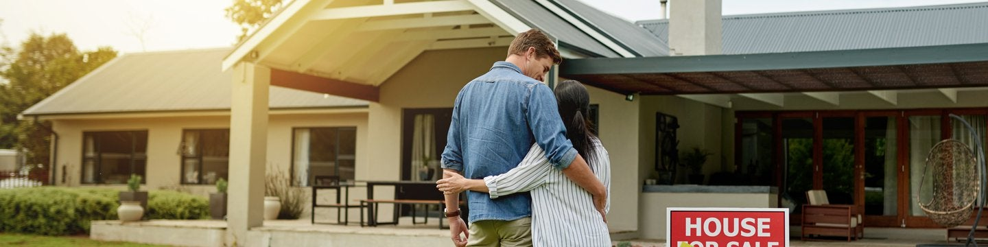 embracing couple at a house