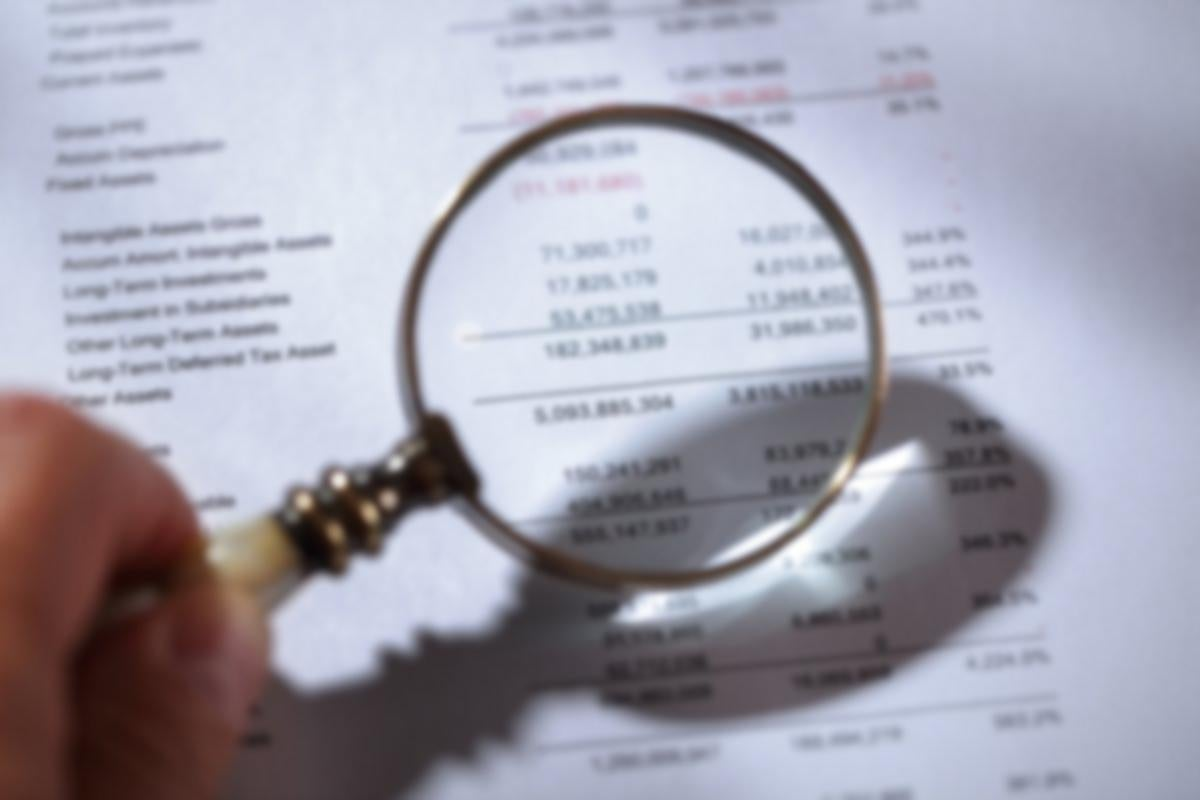 magnifying glass and finance sheet