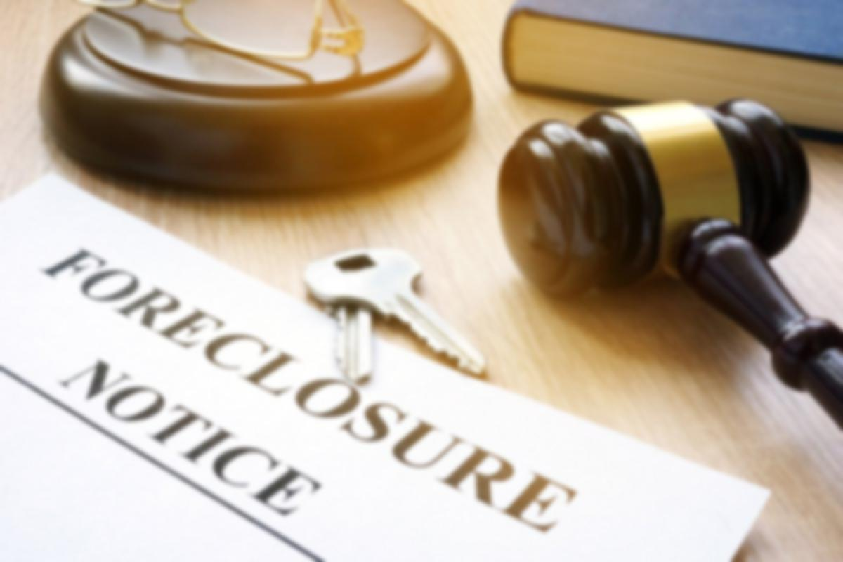 Foreclosure notice with keys and gavel