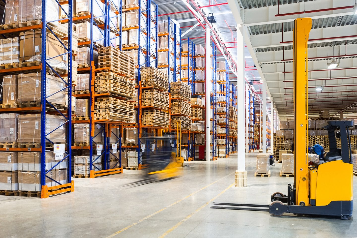 industrial warehouse with fork lift