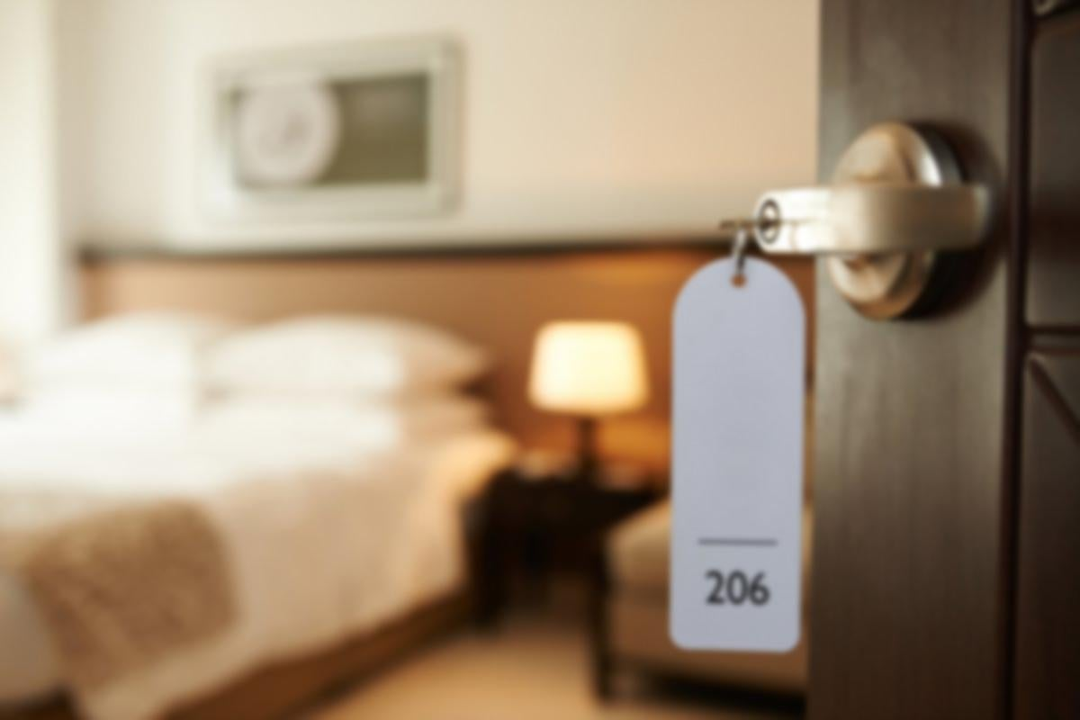 close up of open door in hotel room labeled 206