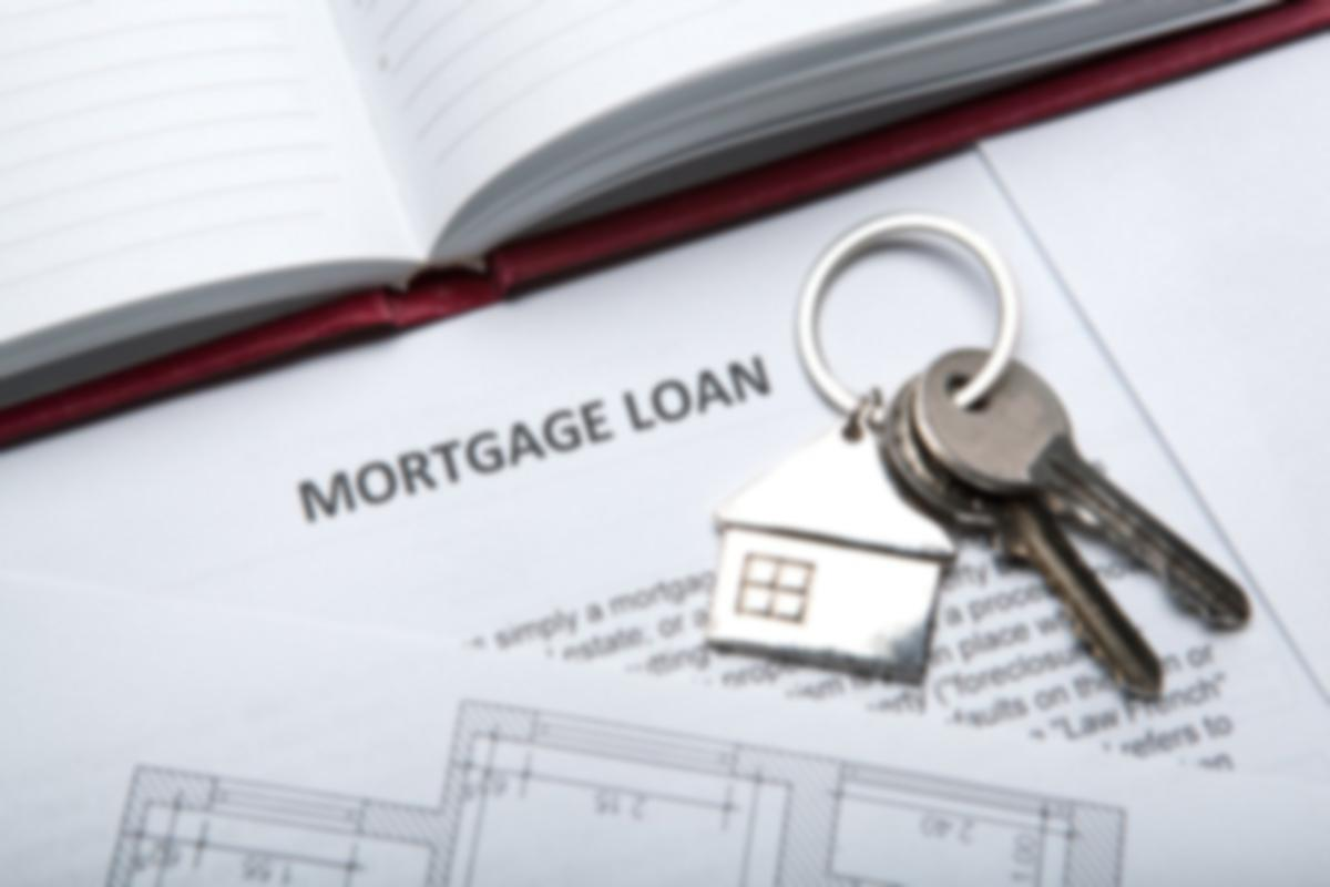 mortgage loan papers with keys