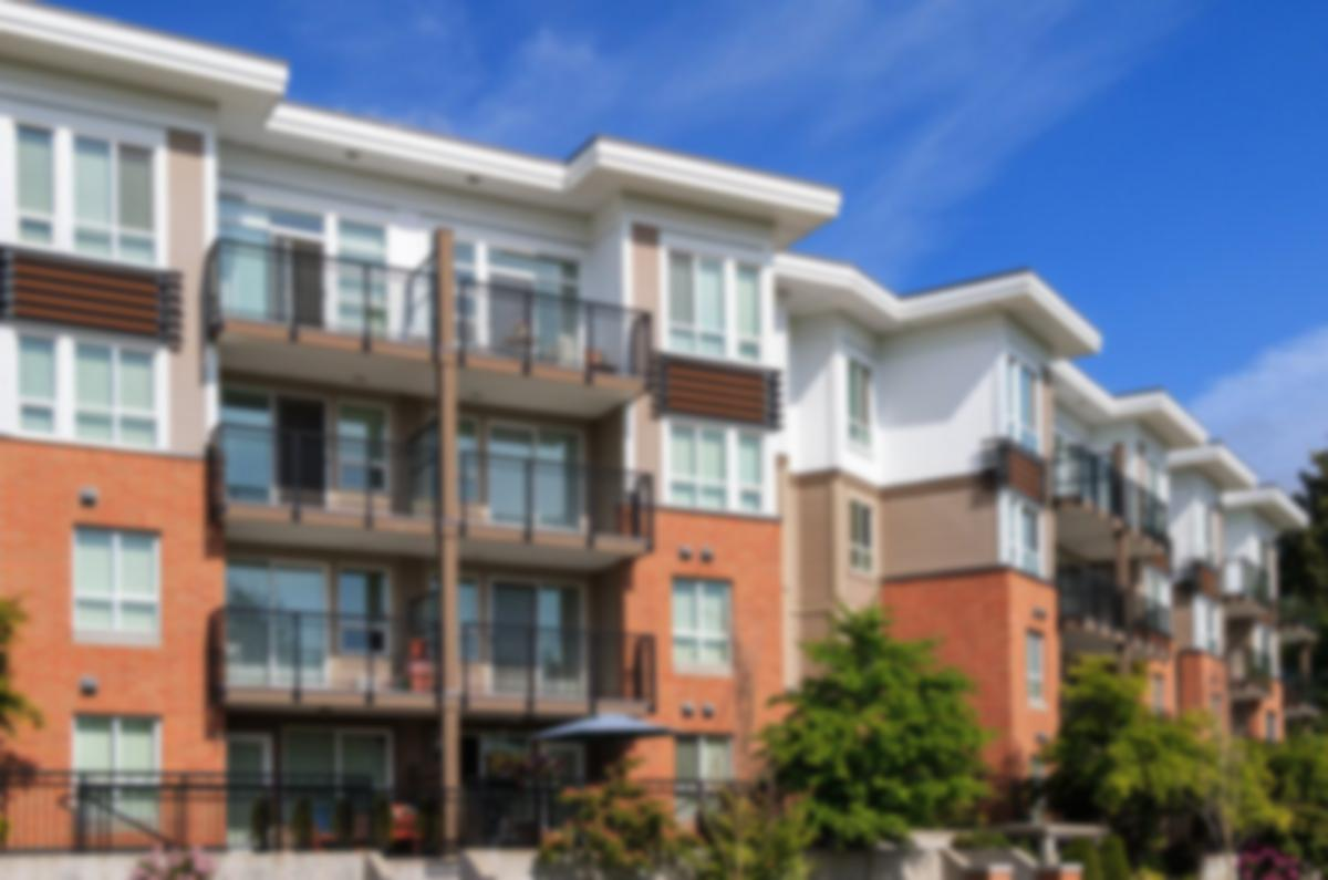 residential condominiums with blue skies