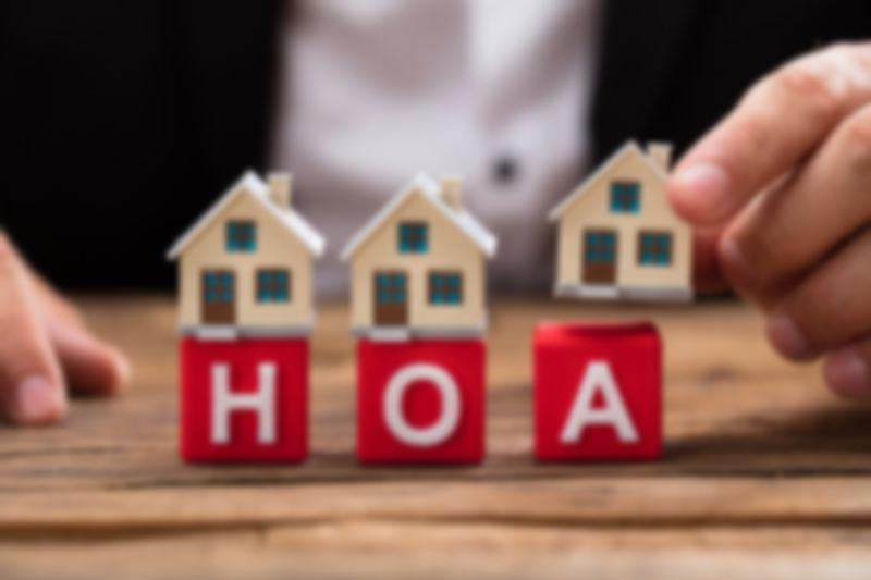 Toy houses sit on blocks spelling out HOA
