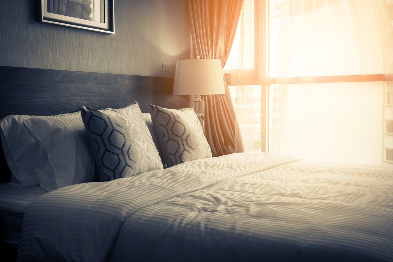 hotel bed sunlight