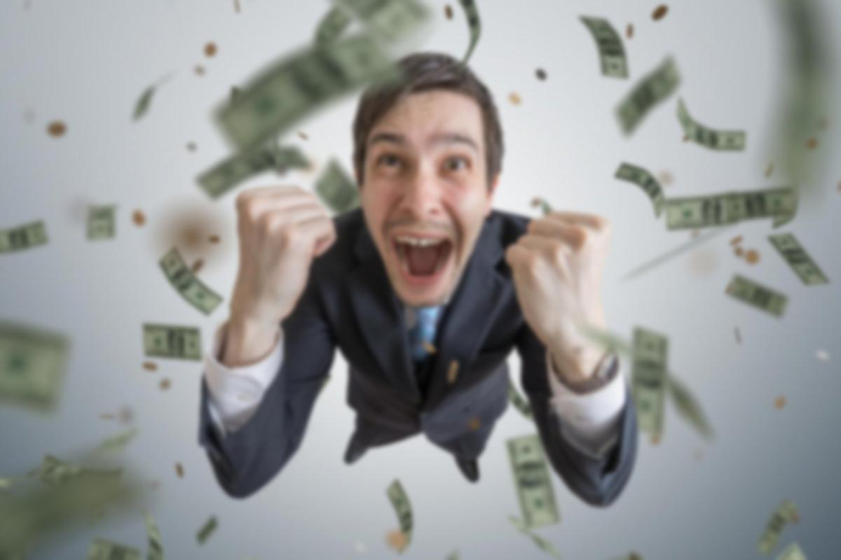 Man with money falling