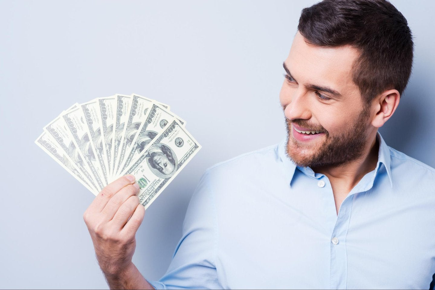 Man smiling with money