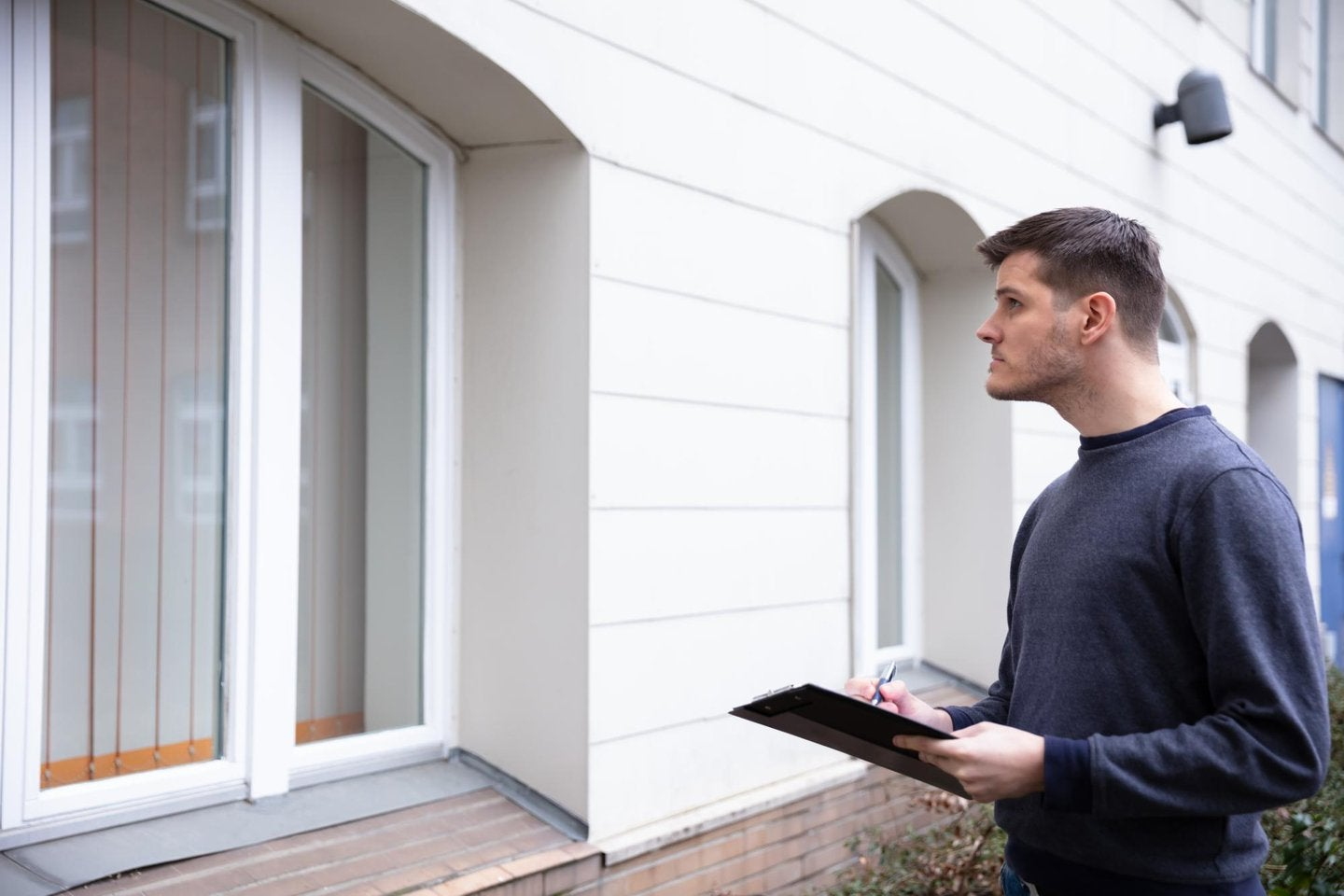 Home inspector looking at a house