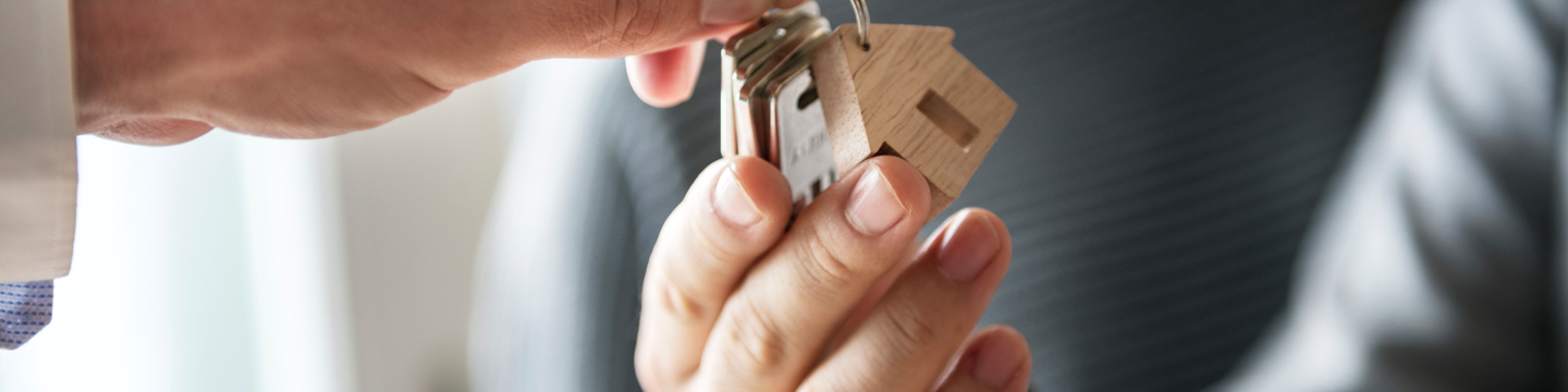 Person being handed house keys