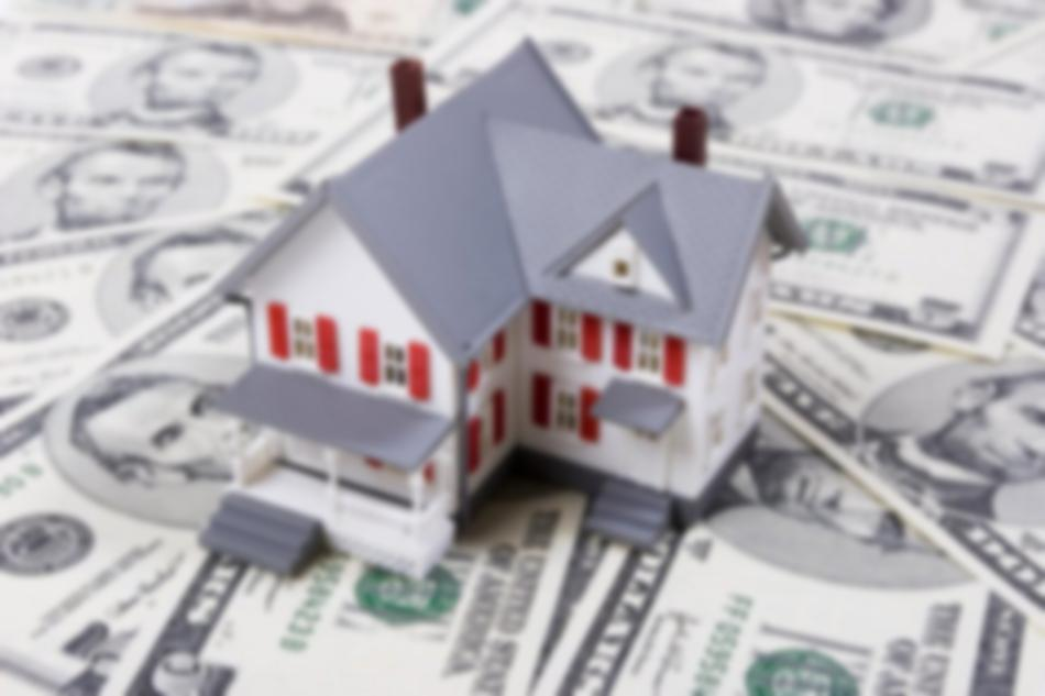 Model house on top of dollar bills