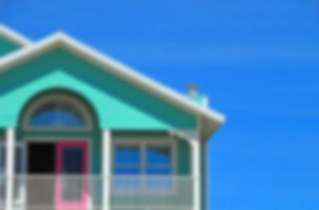 Turquoise house against a blue sky