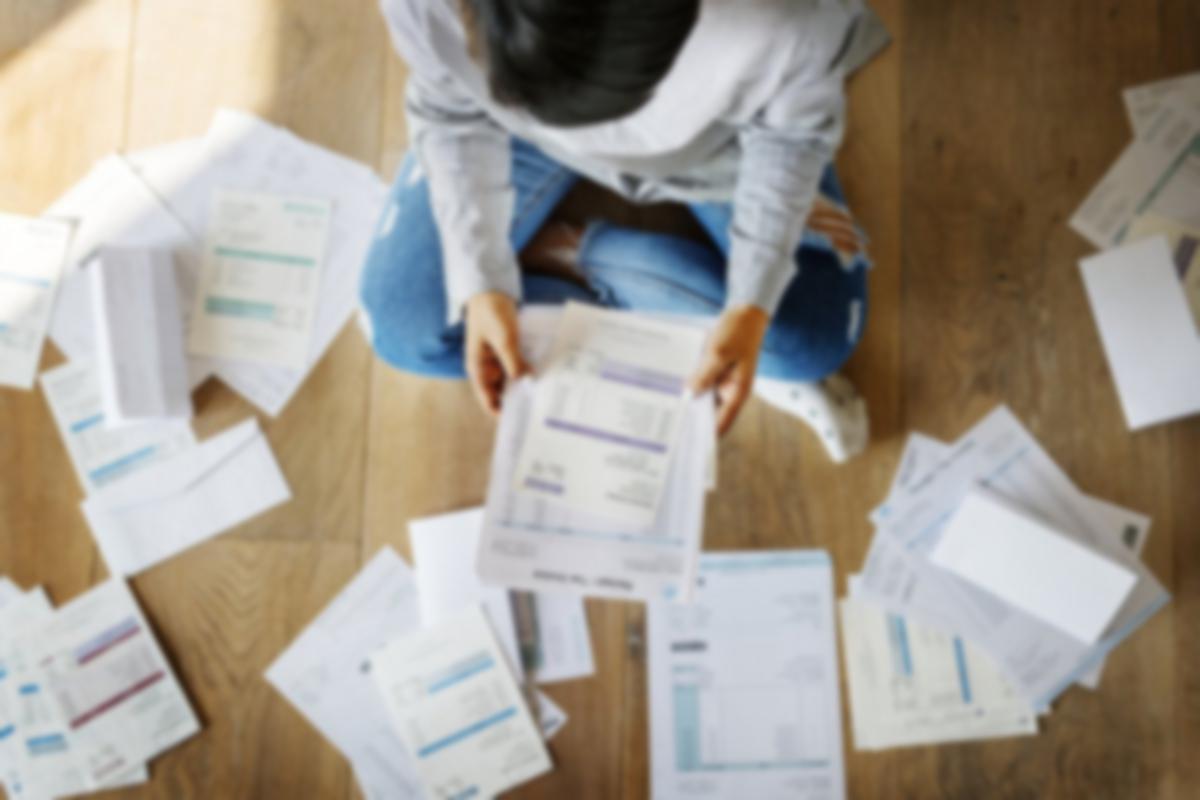 man on floor with bills