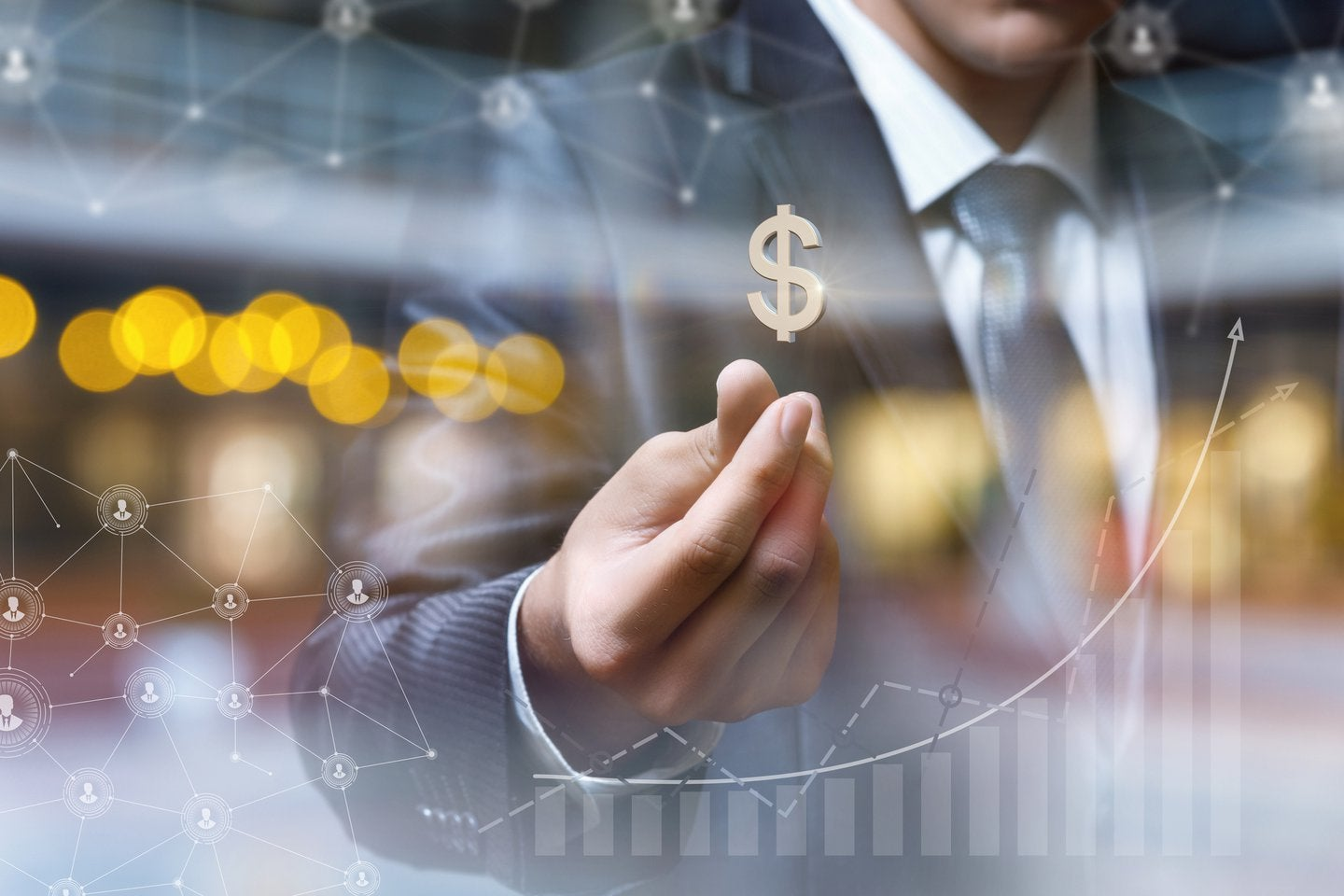 Businessman with dollar sign on blurred background