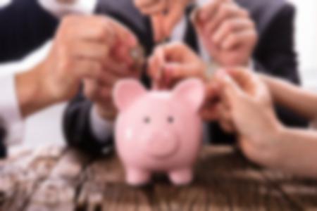 putting money in a piggybank