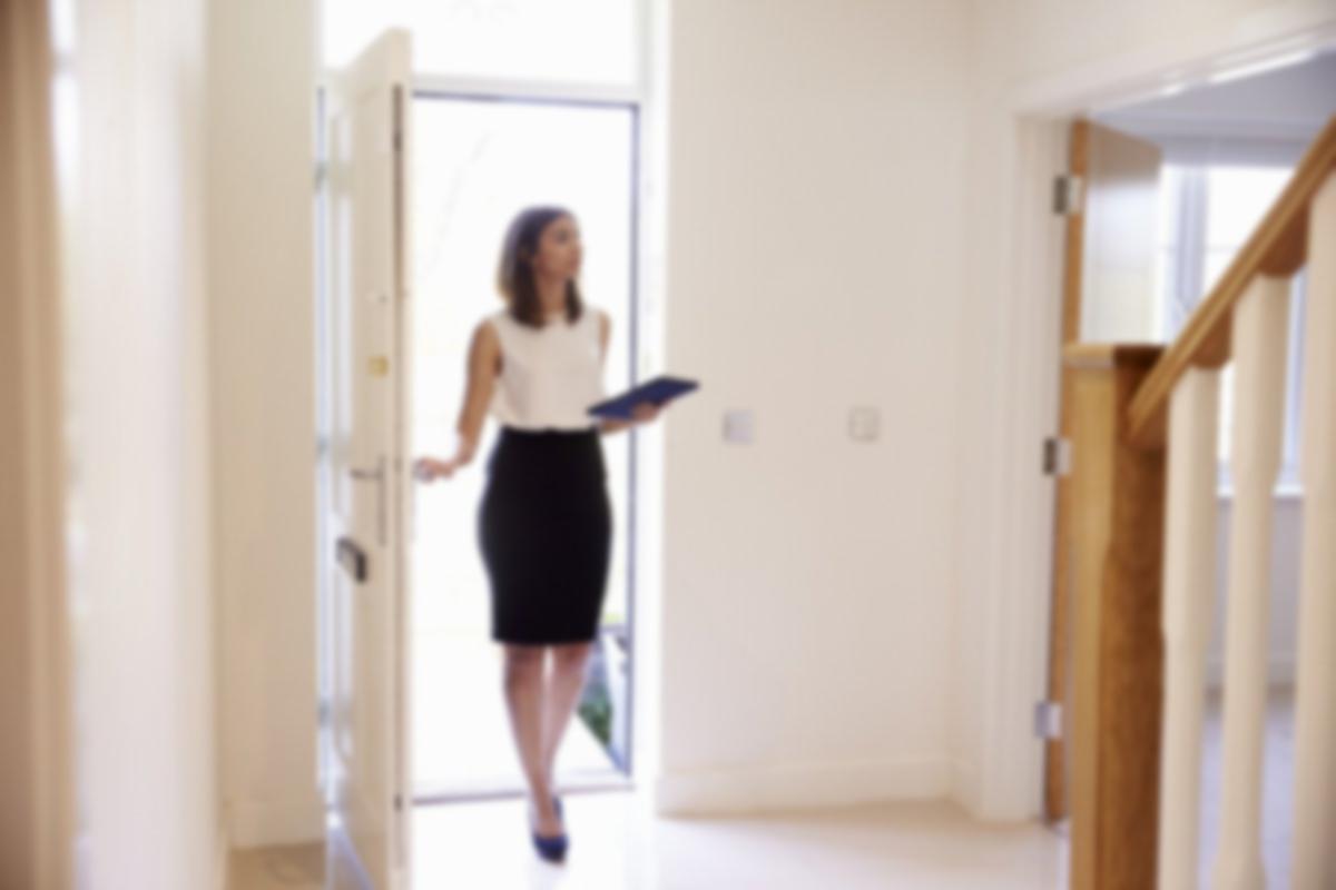 real estate agent walking