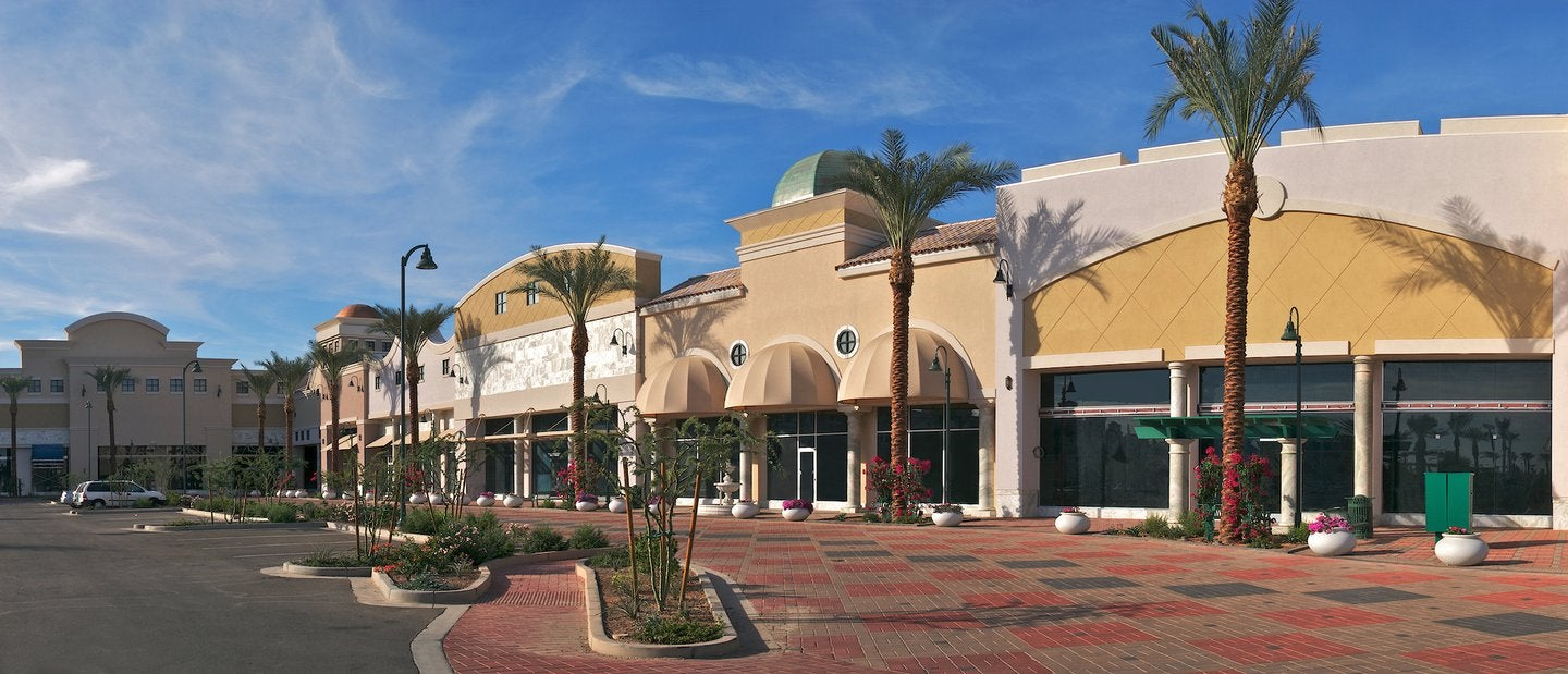 New outdoor shopping mall with palms.
