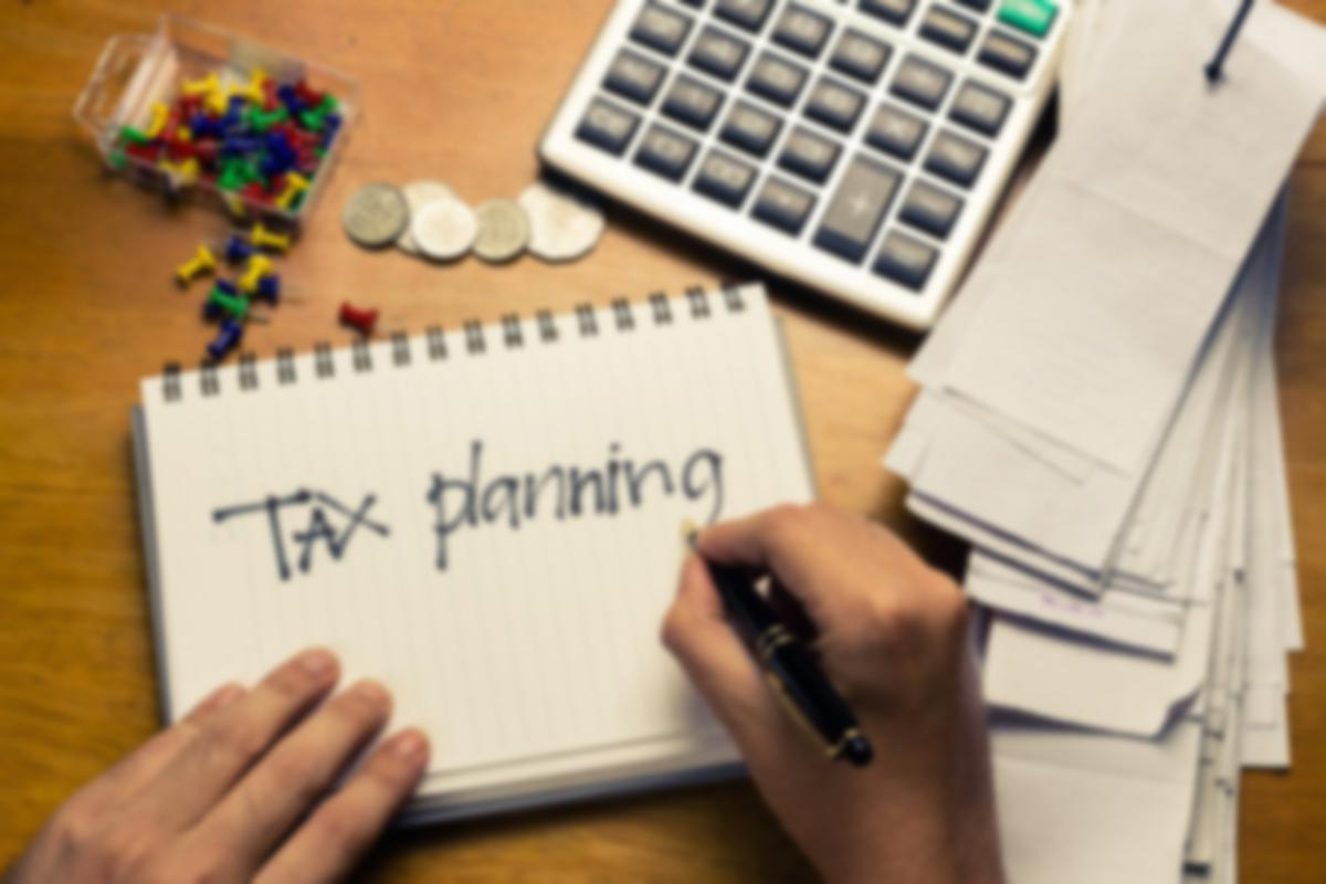 tax planning with calculator and receipts