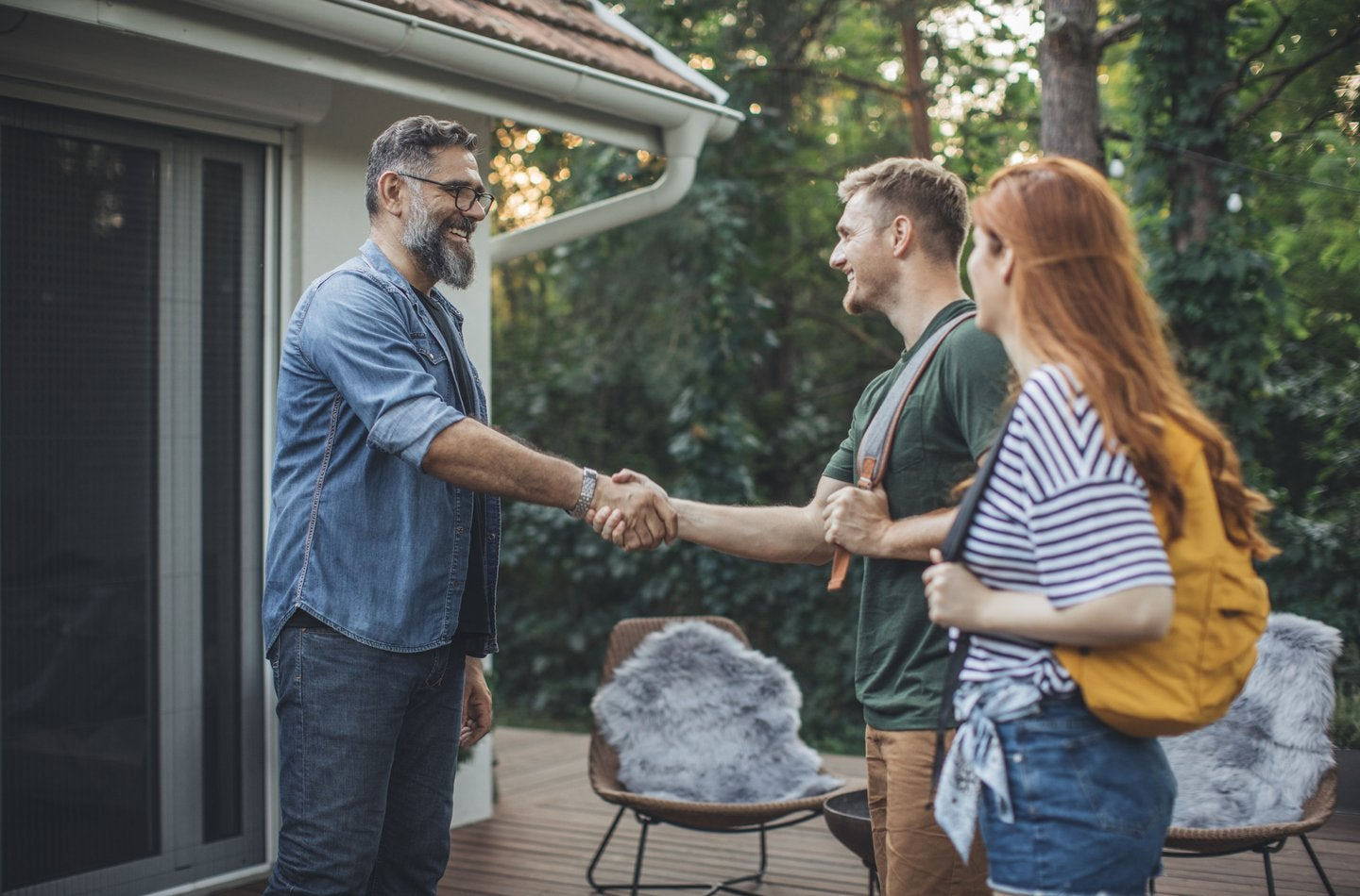 vacationers greeting host