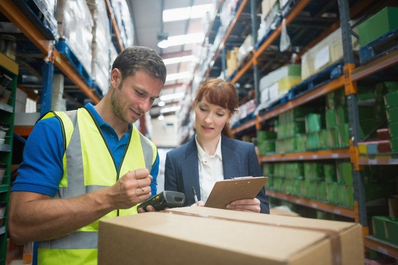 A 3PL manager works with a merchant to review inventory and the fulfillment process.
