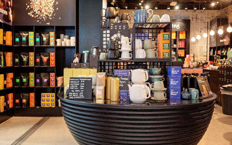 Table display of tea and tea-related products in a store.