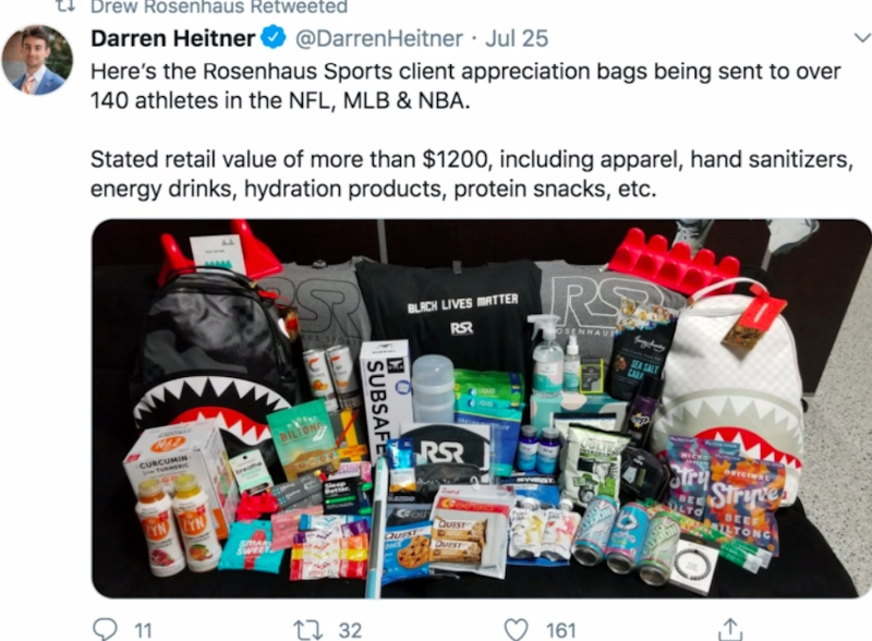 A tweet showing a photo of various snacks, drinks, and merchandise.