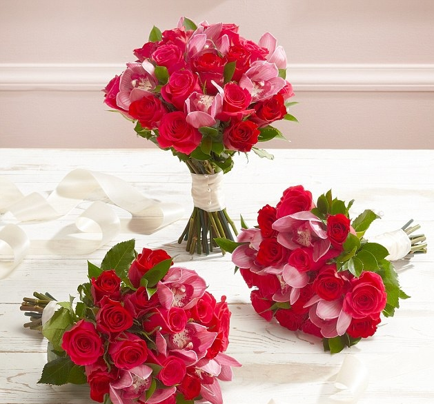 Picture of roses and orchids in three bouquets.