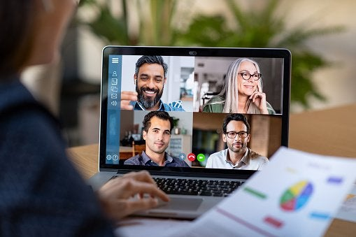 Business team using laptop for an online video call.