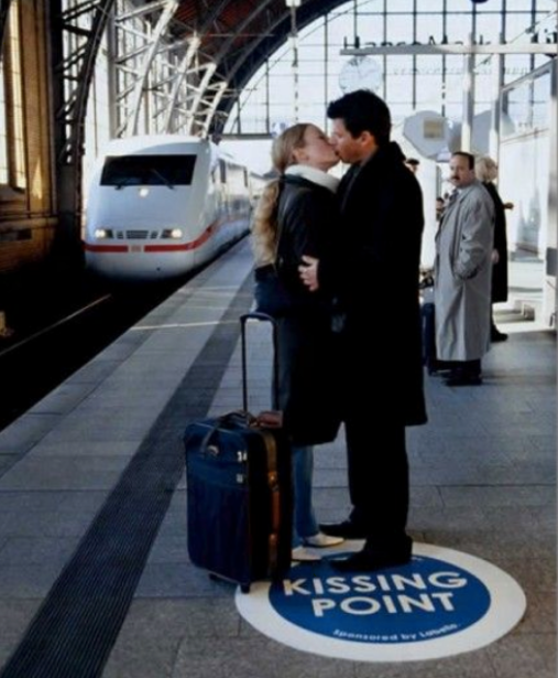 Photo of two people kissing on the kissing point sticker