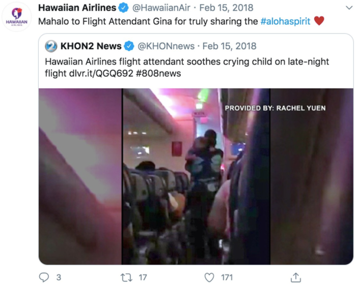 A retweet from Hawaiian Airlines shows a woman carrying a baby in an airplane's passenger aisle.