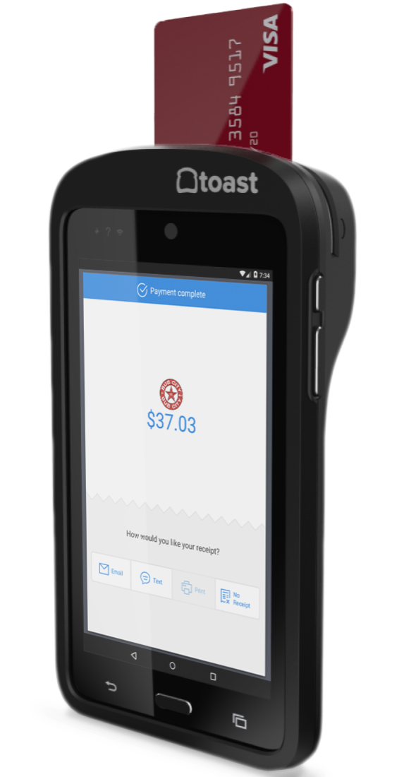 Toast's tableside handheld ordering device is similar in appearance to a smartphone, and a credit card is inserted into the top of it to process payments.