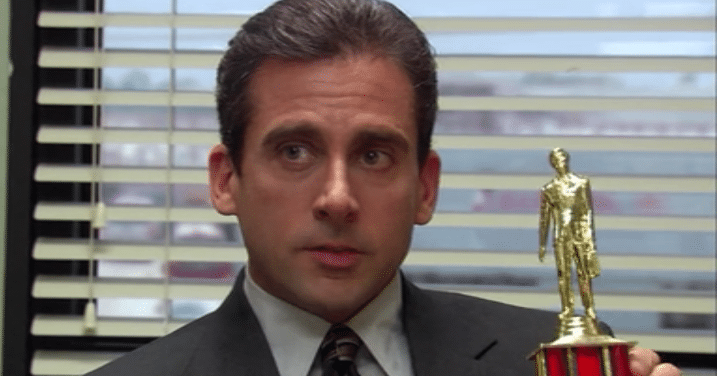Michael Scott, a character from the TV show The Office, holding a trophy.