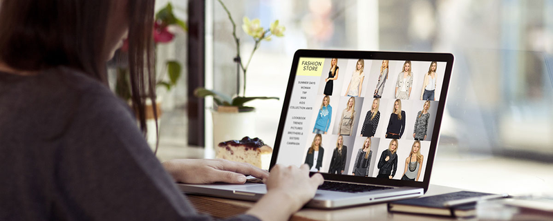 Woman on laptop looking at online clothing store