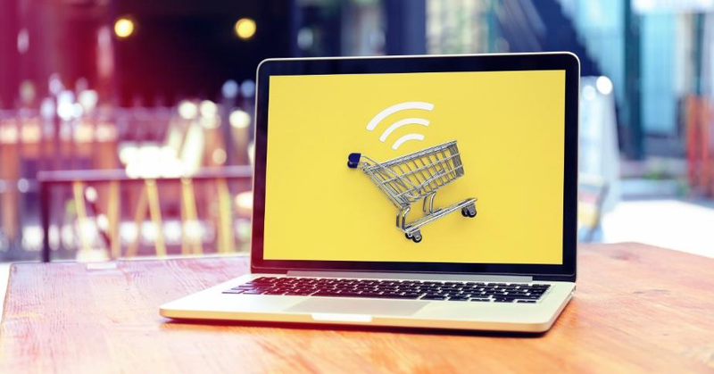 Image of shopping cart on yellow background