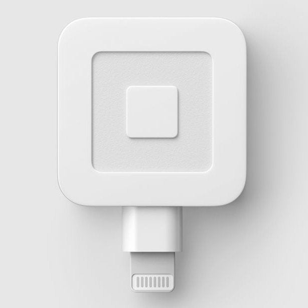 The Square portable credit card reader can be attached to a smartphone to process sales.