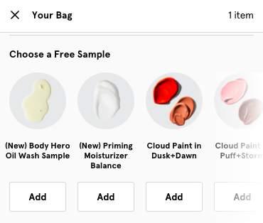 Glossier checkout offers customers a free sample at checkout.