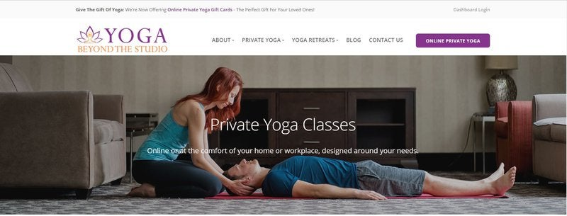 A yoga instructor working with a client.