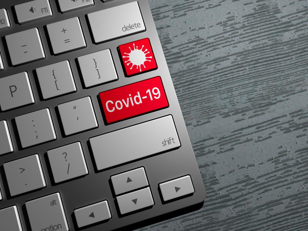 A red keyboard button with coronavirus written on it.