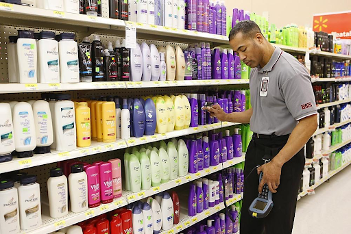 Man taking inventory of products