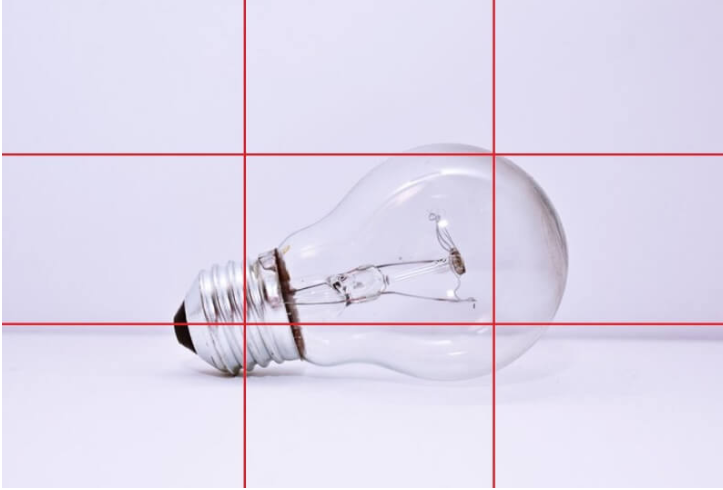 A photograph with a grid displaying a lightbulb positioned at the intersecting lines.