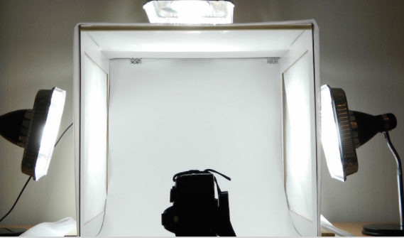 Photo of light box setup with lights on both sides and above.