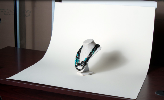 Picture of a necklace against a white paper background.