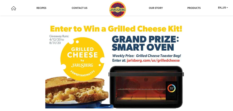 A grilled cheese giveaway is depicted on a computer screen, with a sandwich, smart oven and entry form.