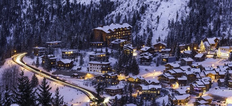 A photo of a ski resort in the mountains.