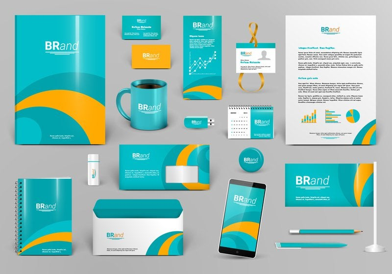 Image showing different marketing and business materials, including business cards and merchandise, all with the same colors, patterns, fonts and overall branding.