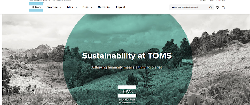 A page from the Toms website calling out its focus on sustainability set over a background of rolling hills.
